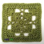 A pretty lace square is shown in a green color.