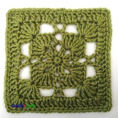 A pretty lace square is shown in a green color.
