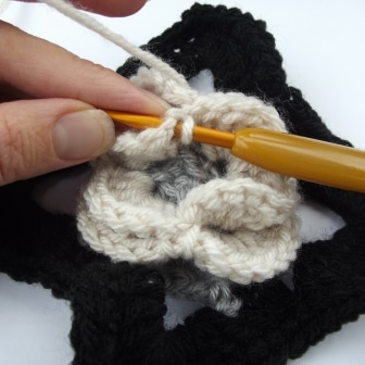 Then slip stitch into the first double crochet in order to finish the round. Fasten off.