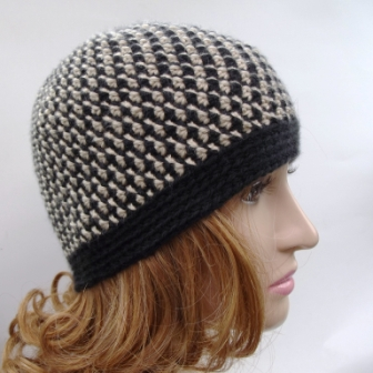 Crocheted with a G/4.00mm from start to finish. It's more like a beanie and will fit adult extra small or children/teens.