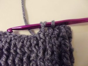 Wrap the yarn over and pull through.