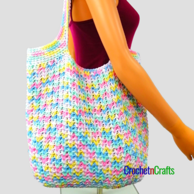 A crocheted bag worn over the shoulder.