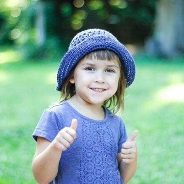 Eyelet Sunhat modeled on a child.