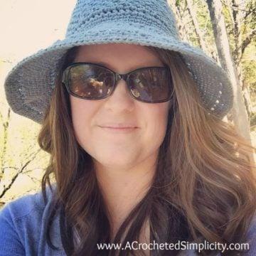A woman wearing a sunhat.