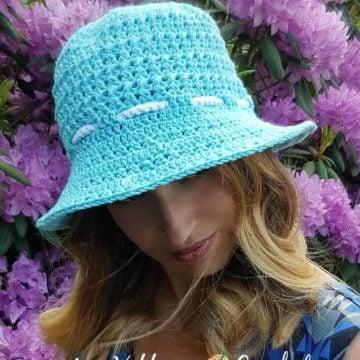 A woman modeling a sun hat.