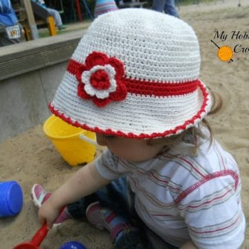 Toddler Sun Hat with Flower modeled on a toddler.