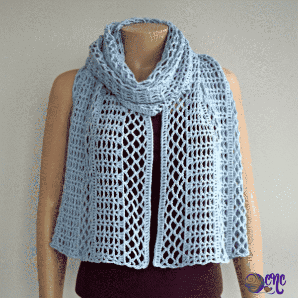 Lacy wrap wrapped around the neck for a cozy winter scarf.