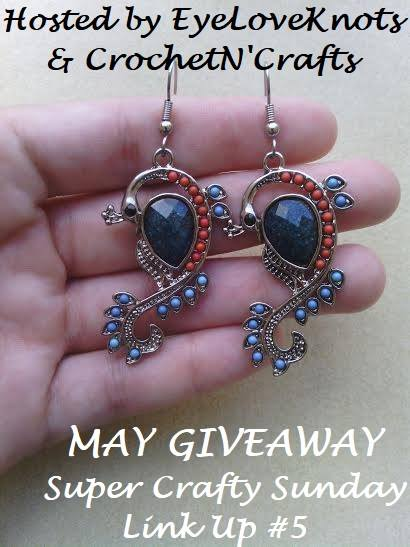 Handcrafted Peacock Earrings shown in the palm of a hand. May Giveaway is sponsored by EyeLoveKnots.