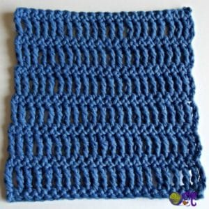 A quick and easy dishcloth pattern laid flat to show off the triple and single crochet stitches.