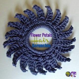 Flower petals hair scrunchie shown flat.