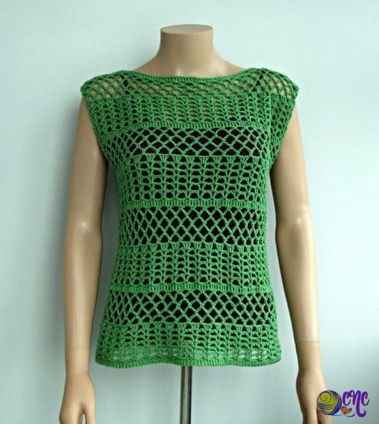 Free crochet pattern for a summer crochet lace top. It is shown here on a mannequin from the front.