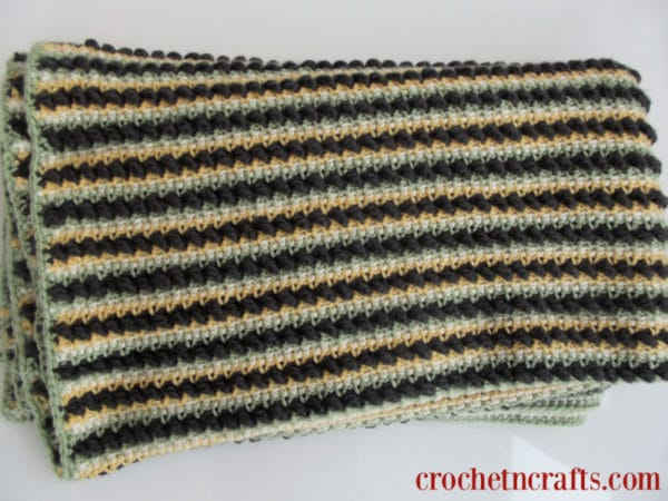 Textured Stripes Crochet Lapghan shown folded up from a closer angle to show stripes and textures.