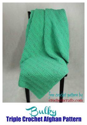 Bulky Triple Crochet Afghan draped over a chair.