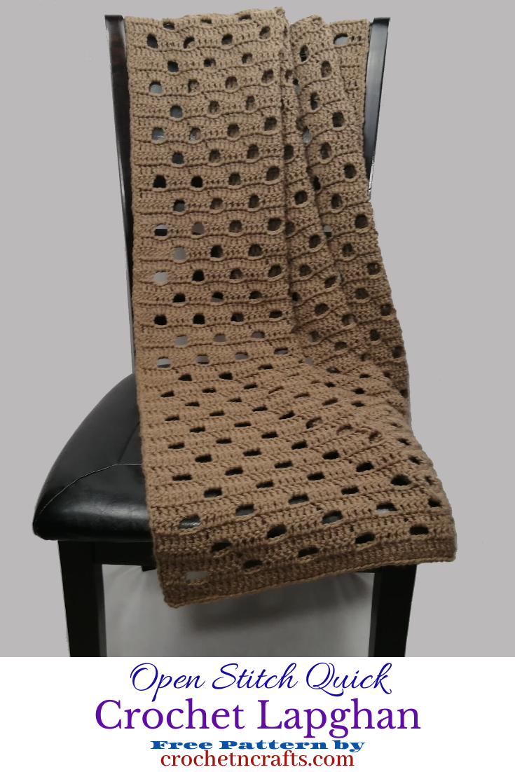 An open stitch crochet lapghan is draped over a chair. The open stitch quick crochet lapghan pattern can be crocheted in a day or two.