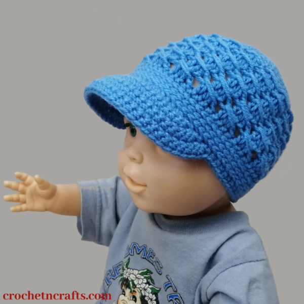 Cross-Over Long DC Free Crochet Newsboy Hat Pattern modeled on a 6-12 month old baby.