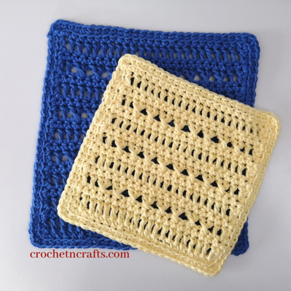 Two crochet washcloths shown in two sizes with the smaller one laid flat on top the large.