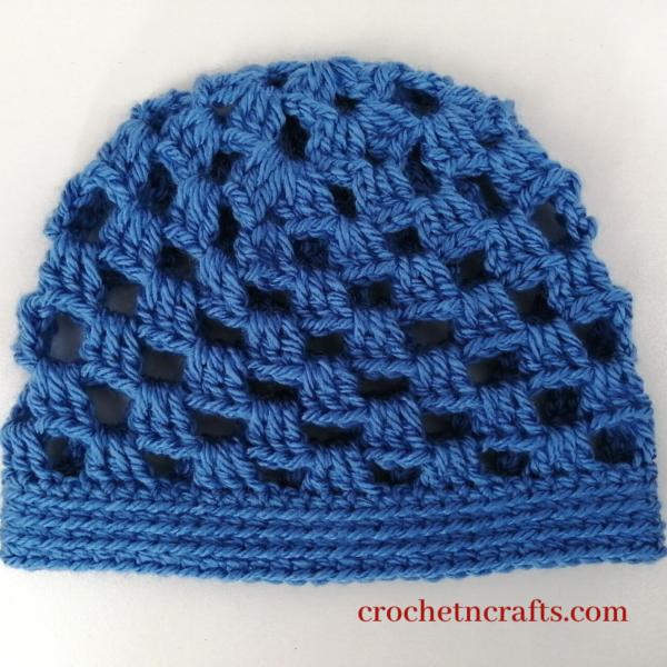 Crochet granny stitch baby beanie laid flat.