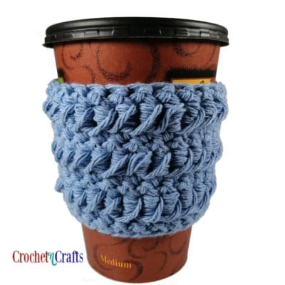 Crochet cup cozy showing the pretty texture from the wrong side.