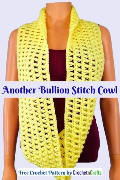 A long yellow cowl crocheted with the bullion stitch.