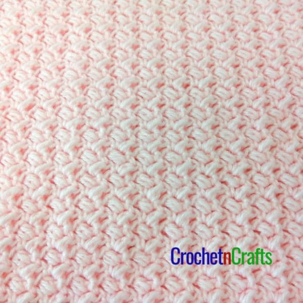 Baby blanket shown closeup so the textures are visible.