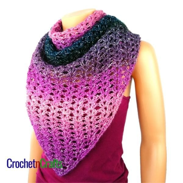 A crocheted shawl wrapped around and worn at the front like a scarf.