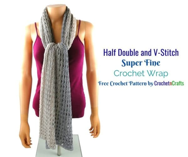 A light and lacy crocheted wrap worn like a scarf.