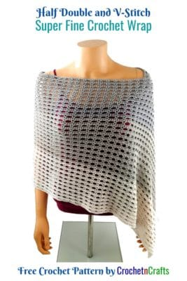 A crocheted wrap wrapped around a mannequin.