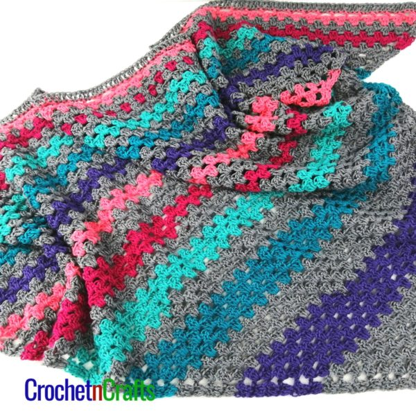 A granny stitch shawl worked up in a self-striping yarn.