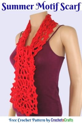 A crocheted motif scarf tied around the neck of a mannequin.