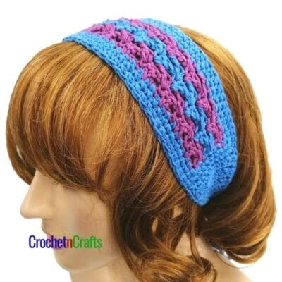 Crochet headband shown in a blue and purple color combo.