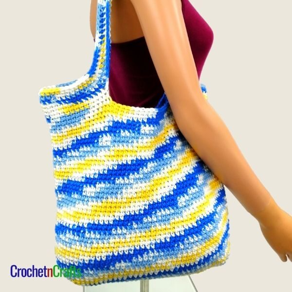 A crochet bag worked up in a variegated yarn.