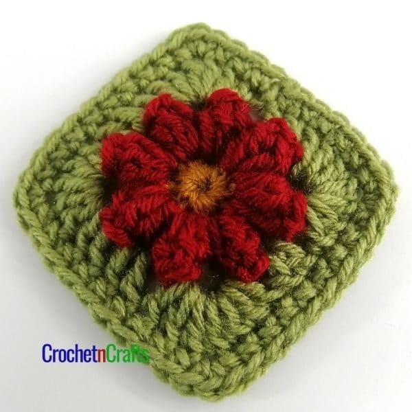 Small popcorn flower afghan square worked up in three colors.