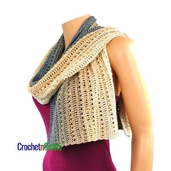 A rectangular shawl draped around the neck and over the shoulders.