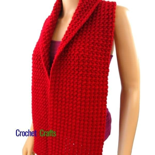 A cozy winter scarf draped over the neck and shoulders. The crochet scarf is worked up in the crunch stitch giving it a nice texture.