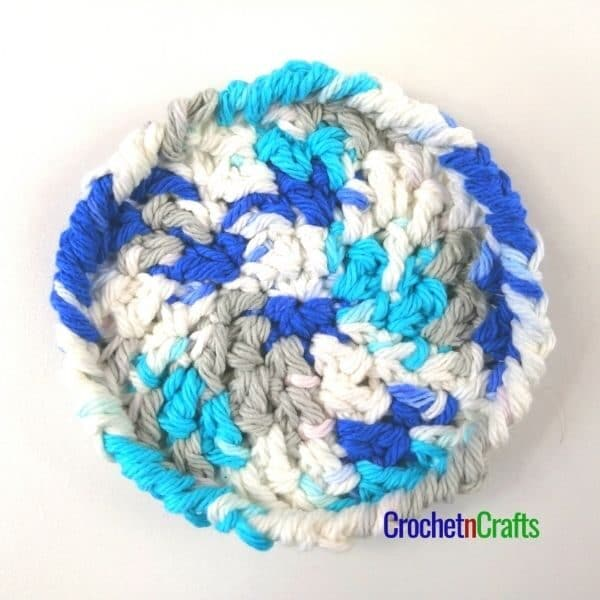 A crochet coaster pattern worked up in a variegated yarn.