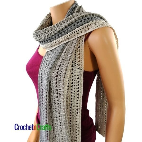 The crochet wrap is bunched up for a cozy winter scarf.