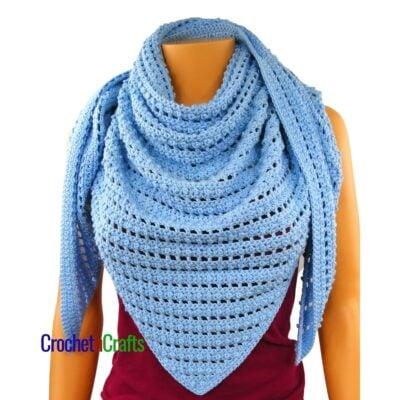 Crochet shawl shown as a cozy triangular scarf.
