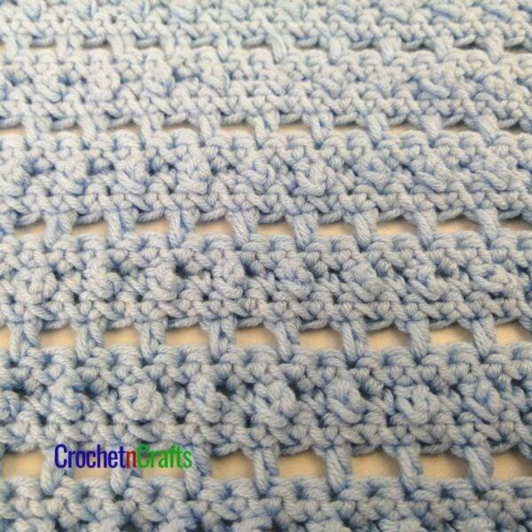 The bead and lace crochet stitch pattern up close.