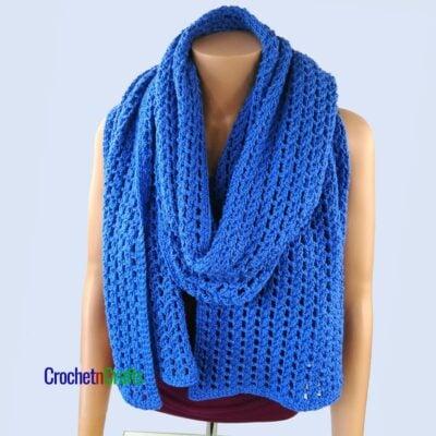 A large shawl draped around like a scarf.