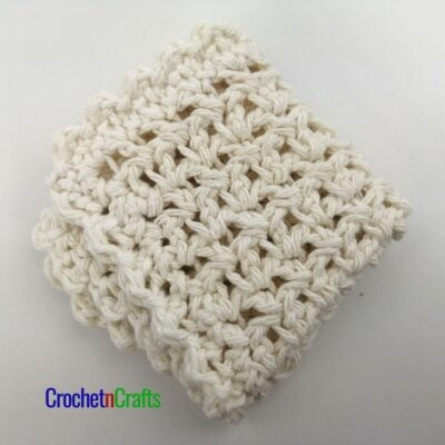 Folded up dishcloth worked up in the extended single crochet.
