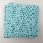 Moss stitch crochet dishcloth in a solid color.
