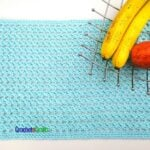 An open stitch crocheted placemat.