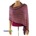 A red, white, and blue striped crocheted shawl draped over the shoulders.