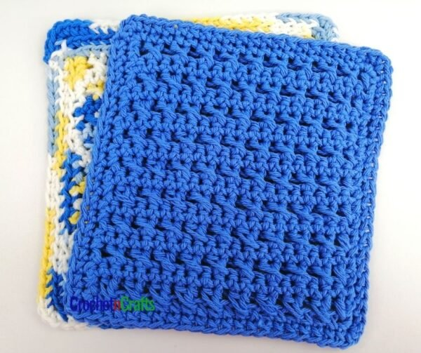 A crochet cross stitch dishcloth shown in a solid color.