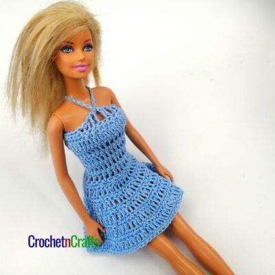 A short crochet Barbie dress shown in blue.