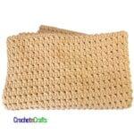 A super bulky crochet child's blanket pattern folded up.