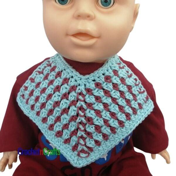 Cotton bib shown on a 6-month baby mannequin.