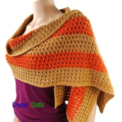 Crochet Fall Wrap Draped Over the Shoulders.