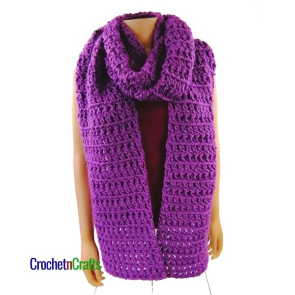 Crochet super scarf wrapped cozy around the neck.