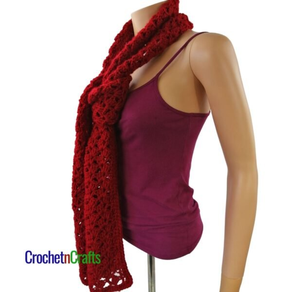 A lacy crochet scarf tied at the front.
